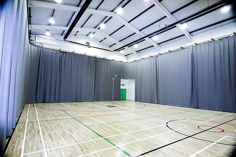Perimeter track and curtains sports Hall Manchester Uni