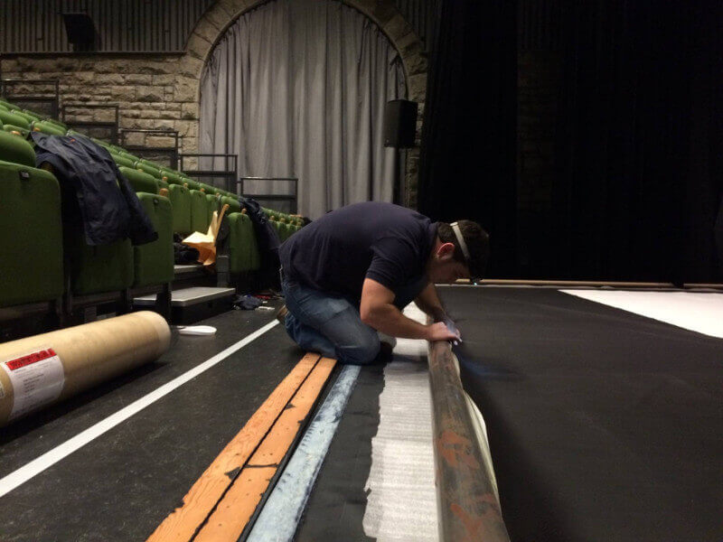 A Camstage worker gets the roller screen ready at Wyeside