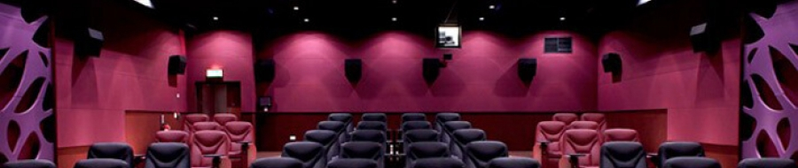 A bright red soft wall treatment affects  cinema acoustics
